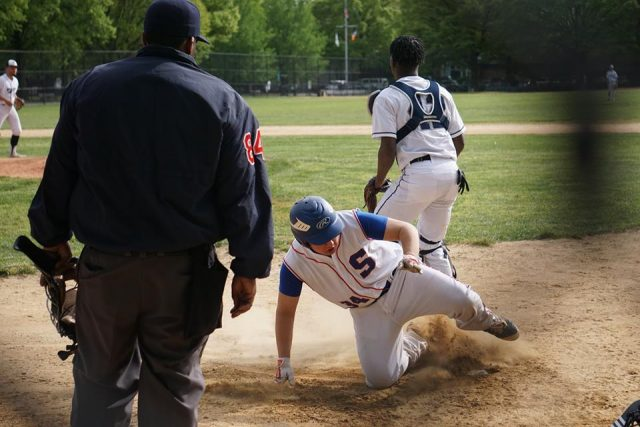 Dean Steinman scores in the first inning of the Pegleg victory over John Bowne