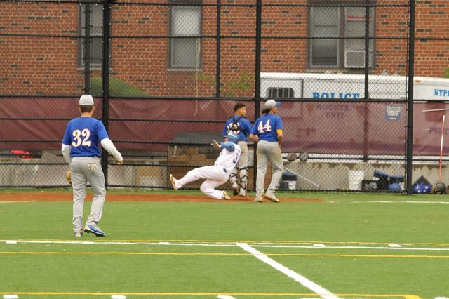 Dean Steinman scores winning run against Bryant.