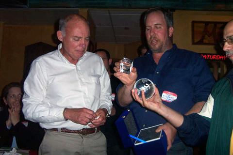 Coach Charles Sharkey receives engraved glass award from Tom Gilbert, Treasurer of the Friends of Stuyvesant Baseball.