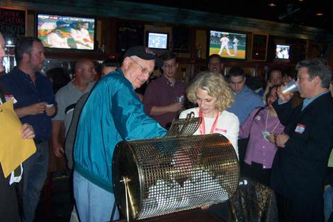 Art Horowitz ('53) draws raffle winners at Mudville 9.