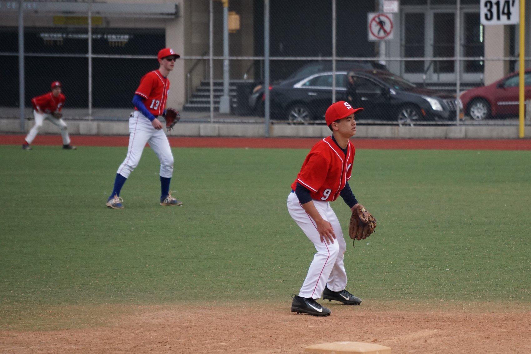 Franklin Liou manning third base